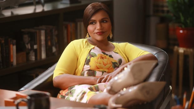 main-the-mindy-project-yellow-sweater-floral-dress-rockstud-shoes