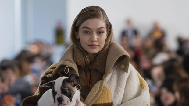gigi hadid and a PUPPY at tod's fall 2018