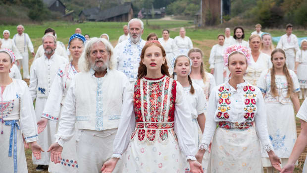 main-midsommar-movie-harga-white-dress-red-embroidery