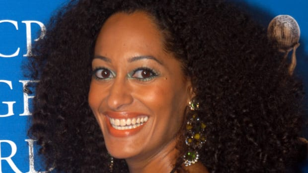 tracee-ellis-ross-green-liner-orange-lips-promo