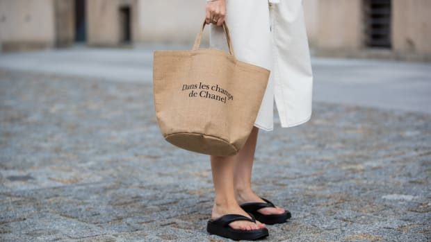 Swantje Soemmer is seen wearing white dress Blanche, Arket plateau flip flops, Chanel beach bag on July 07, 2020