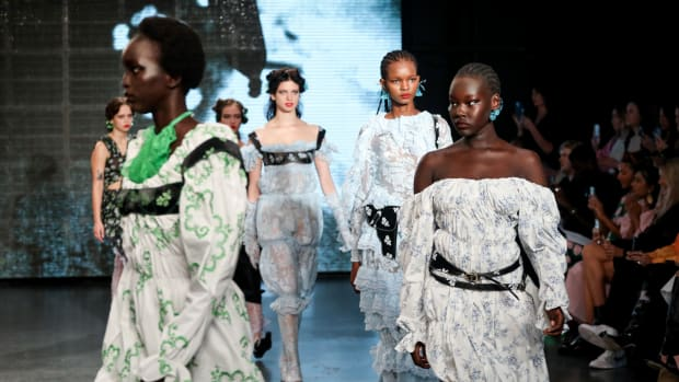 Models walk the runway during the finale at the Yuhan Wang show at TikTok Show Space during London Fashion Week September 2021