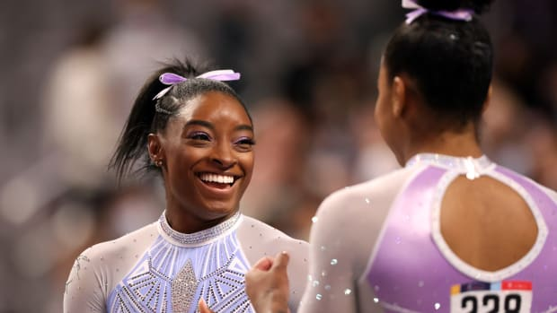 Simone Biles #227 and Jordan Chiles #228 joke while warming up for the beam during the Senior Women's competition of the 2021 U.S. Gymnastics Championships
