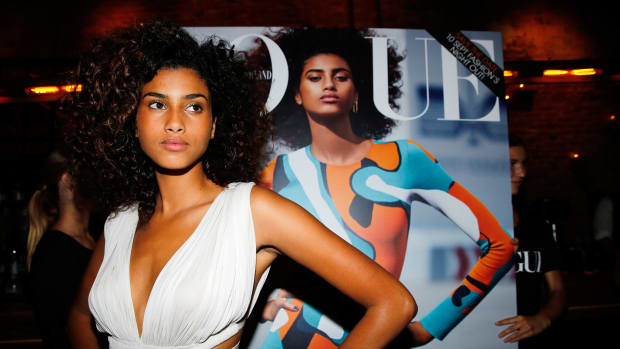 Dutch model Imaan Hammam poses during the launch of Vogue's September Issue in Amsterdam on August 6, 2015