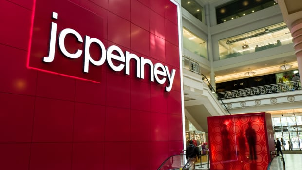 Signage is displayed at the entrance of a JC Penney department store inside the Manhattan Mall