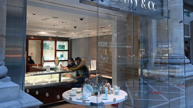 Customers wear a face covering as they shop in Tiffany & Co at The Royal Exchange on April 12, 2021 in London, England.