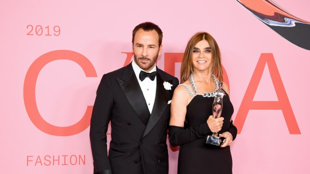 Carine Roitfeld poses the Founder's Award in Honor of Eleanor Lambert Award and Tom Ford during the Winners Walk during the CFDA Fashion Awards at the Brooklyn Museum of Art
