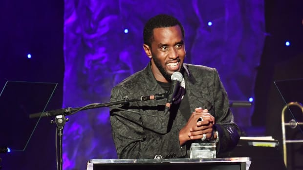 """Sean """"Diddy"""" Combs accepts the President's Merit Award onstage during the Pre-GRAMMY Gala and GRAMMY Salute to Industry Icons"""