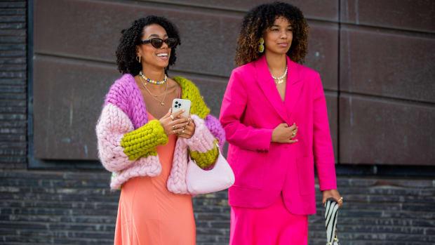 Guests seen wearing knitwear outside Mother of Pearl on August 11, 2021 in Copenhagen, Denmark.