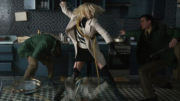 main-atomic-blonde-charlize-theron-white-coat-stuart-weitzman-boots