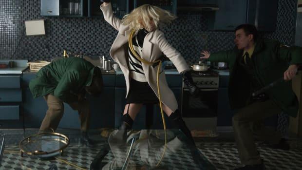main-atomic-blonde-charlize-theron-white-coat-stuart-weitzman-boots