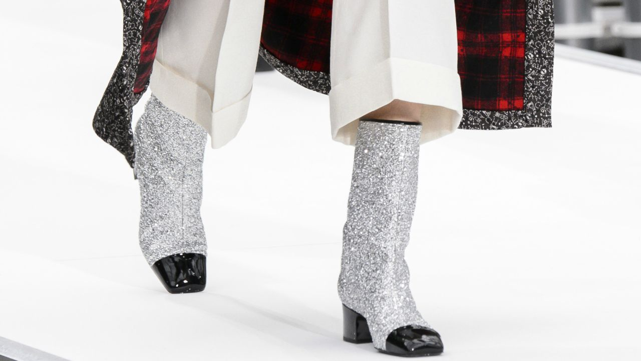 chanel glitter boots. glitter boots were the single breakout shoe trend of fall 2017 fashion month chanel fashionista