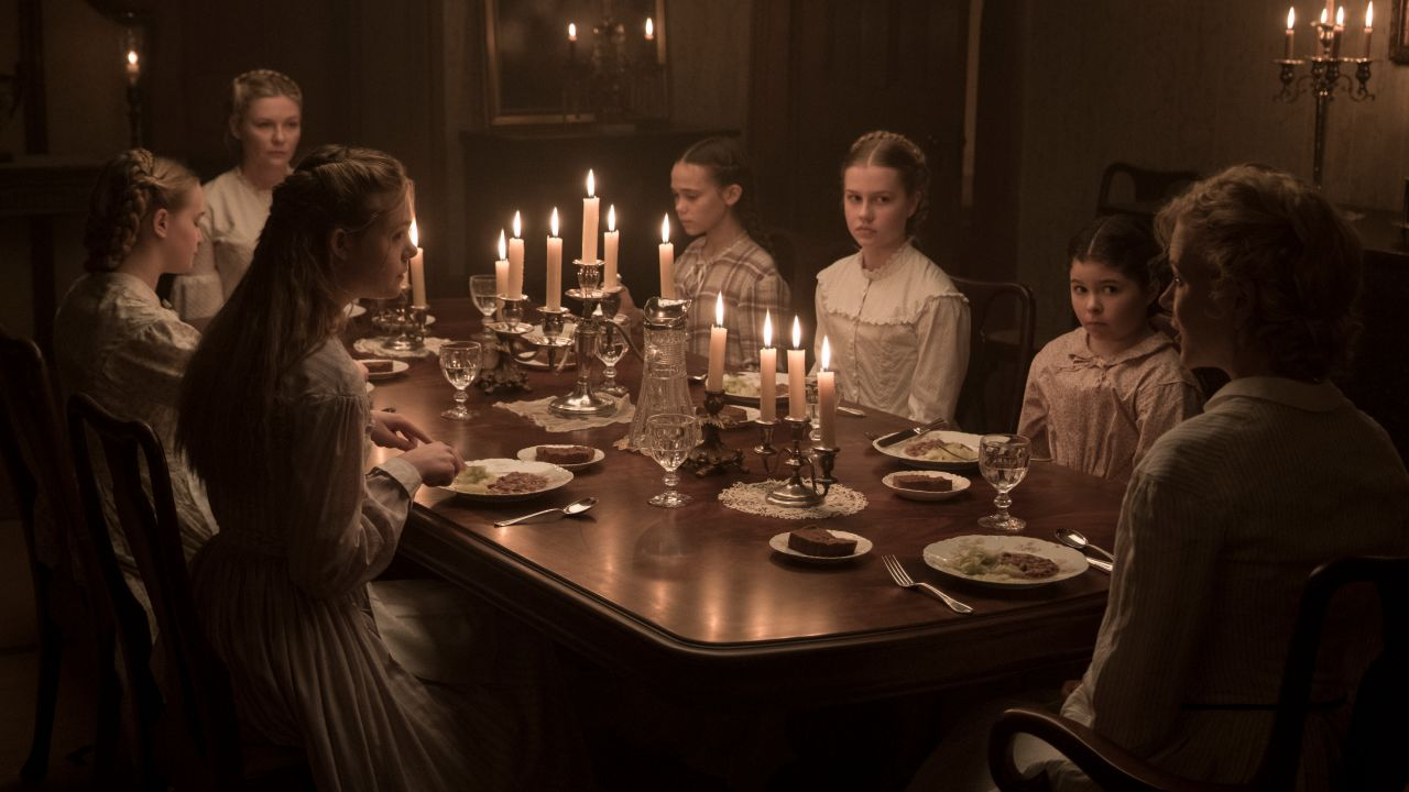 https://fashionista.com/.image/ar_16:9%2Cc_fill%2Ccs_srgb%2Cq_80%2Cw_1280/MTQ3ODUyMzkwNTE3NzEyODE4/the-beguiled-dinner-scene.jpg