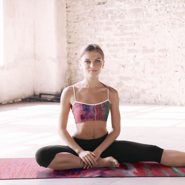 sports-bra-mockup-featuring-a-young-woman-sitting-on-a-yoga-mat-37835-r-el2