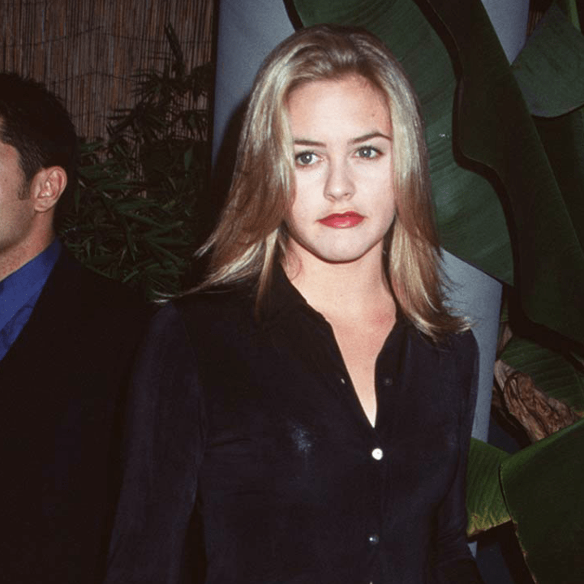 Great Outfits in Fashion History: Alicia Silverstone Channeling Cher Horowitz in a Silky Button-Down - Fashionista