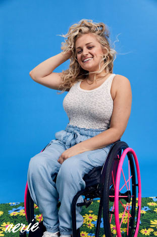 """""""I was so excited and moved by this opportunity because I really believe in representation. To be able to be a role model, be a woman in a wheelchair and get to represent that for all young girls in chairs is a dream come true for me, first and foremost. Also I love Aerie — I legitimately shop there all the time. I love that they do this; you actually see in their ads people with real bodies, people that look like me and like my friends.My motto, and something that I want to bring to this opportunity, is turning your limitations into your opportunities. One of the ways that I want to do that is by creating a lot more exposure around access. There are so many places still in the world that are really difficult for people who have mobility issues to get to, like the beach, and places that mean a lot to me like getting onstage. If there is a will there is a way. Are there ways to provide ramps, lifts and beach wheelchairs, beach pathways, to more people so they can enjoy those parts of life?[The photoshoot] has been so cool. When you're in front of the camera alone, it's one experience, but to be in front of the camera with a whole team of powerful women is really exciting. You feel the energy and you feel the power that you have to be able to capture a moment where all these women are coming together with a message to try to encourage and inspire people to be authentic and be themselves.I am excited about hopefully helping them design some accessories for wheelchairs and for mobility assisted products and tools. I hope that we can come up with some creative, cool things; I think it will be really exciting to see what things we'll be able to create and design together for my community.Something that's really beautiful about being given this opportunity is now I have to remember what it means to be a role model all the time. Part of that is being kind and gentle to myself. If you are taking on the role as being a role model, you have to think about, what are you going t"""