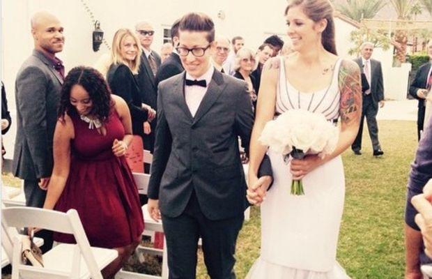 A wedding couple both wearing bespoke Sharpe Suiting. Photo: Sharpe Suiting.