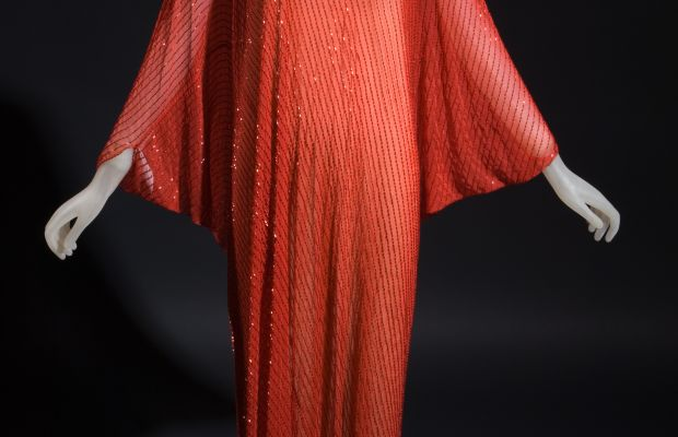 A red evening caftan by Halston, c. 1977. Photo: FIT Museum