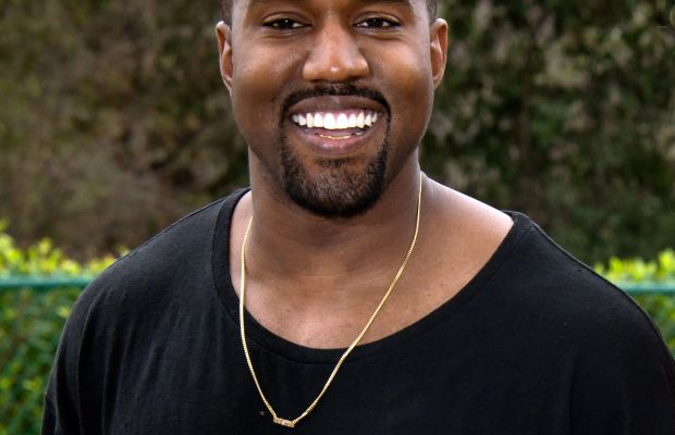 Kanye West, smiling! Photo: Amanda Edwards/Getty Images
