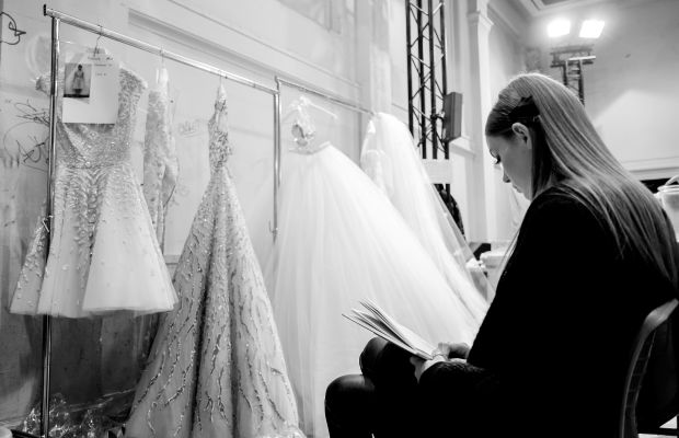 A model reading backstage before the Zuhair Murad couture show in Paris. Photo: Gareth Cattermole/Getty Images
