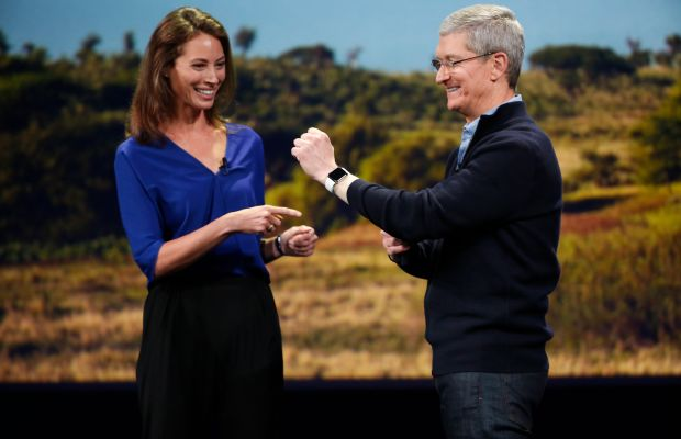 Turlington Burns with Apple CEO Tim Cook. Photo: Stephen Lam/Getty Images