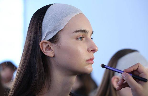 A model, who does not need foundation, backstage at NYFW. Photo: Mireya Acierta/Getty Images