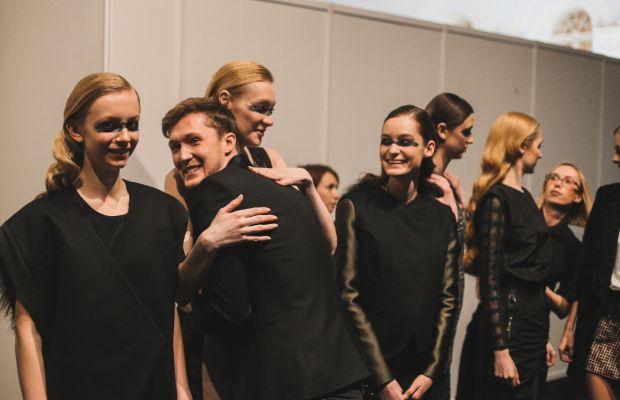 Saint-Tokyo designer Yriy Pitenin with models before his fall runway show. Photo: Mercedes Benz Fashion Week Russia