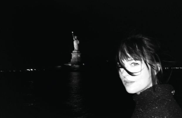Dakota Johnson on a boat, New York. Photo: Alexa Chung/Paper