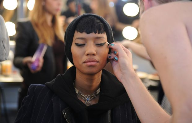 A model gets her makeup done during New York Fashion Week. Photo: Ilya S. Savenok/Getty Images