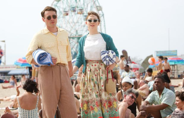 Beach fashion circa 1950, as modeled by Tony (Emory Cohen) and Eilis (Saoirse Ronan). Photo: Kerry Brown/Twentieth Century Fox Film Corporation