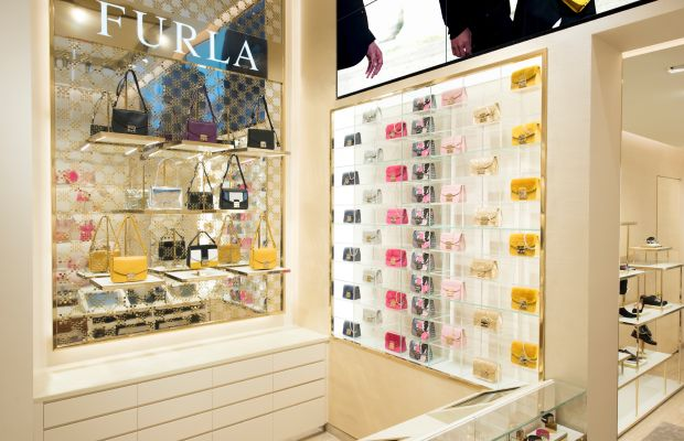 Inside Furla's new Fifth Avenue flagship, where the company's best-selling Metropolis bag is on display (right). Photo: Furla