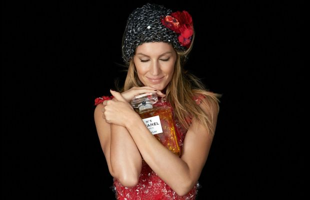 Gisele totally loves this huge bottle of Chanel No. 5, and it's not even a purse! Photo: Chanel