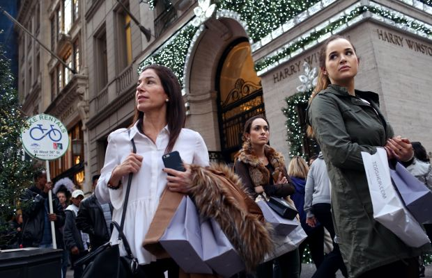 Shoppers took to stores — and their phones — to shop over Thanksgiving Weekend. Photo: Yana Paskova/Stringer