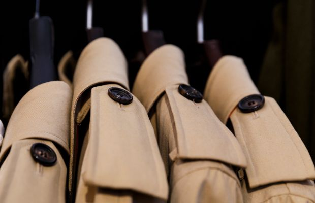 Burberry trenches backstage at a runway show. Photo: Tristan Fewings/Getty Images