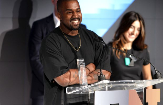 """Kanye West accepts the award for """"Shoe of the Year"""" at the 2015 Footwear News Achievement Awards, sponsored by Zappos Couture. Photo:  REX/Shutterstock"""