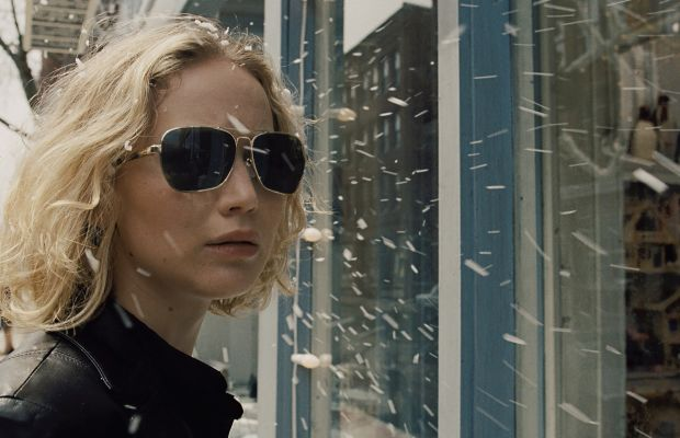 Jennifer Lawrence as Joy Mangano in her badass leather jacket and vintage aviators. Photo: Twentieth Century Fox