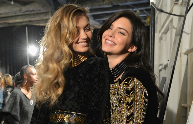 Gigi Hadid and Kendall Jenner backstage at the Balmain x H&M collection launch in October in New York City. Photo: Slaven Vlasic/Getty Images
