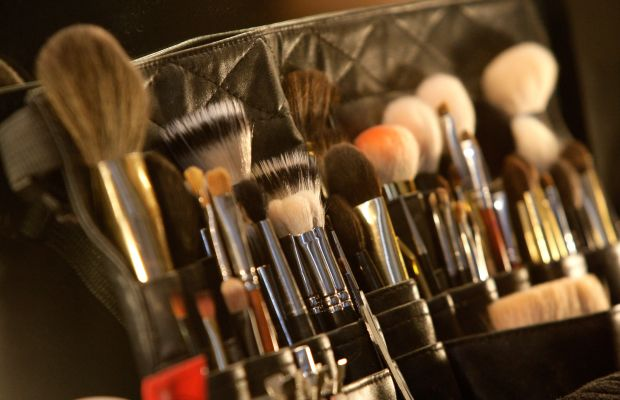 A makeup artist's brush kit backstage at a runway show. Photo: Lisa Maree Williams/Getty Images