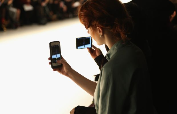 Fashion week attendees are often so focused on capturing images on their smartphones, they miss out on the show experience. Photo: Monica Schipper/Getty Images Entertainment