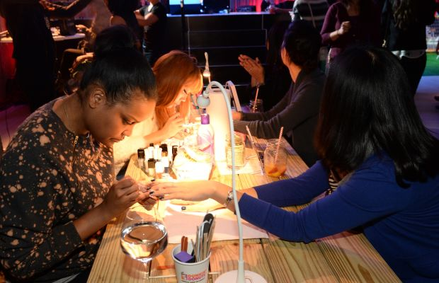 Women get manicures during a Smirnoff Ice event. Photo: Rick Diamond/Getty Images