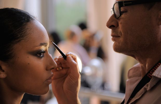 Makeup artist Tom Pecheux plies his craft. Photo: Jemal Countess/Getty Images.