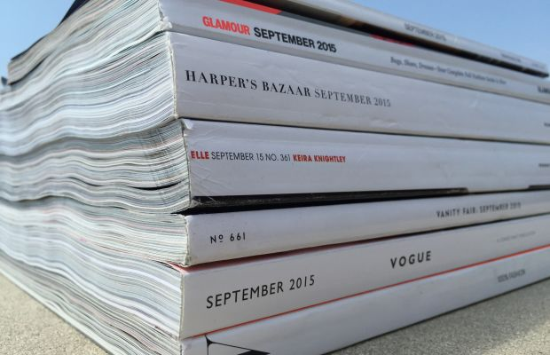 Behold the spines of the fashion magazines whose ad pages we counted three times. Photo: Fashionista