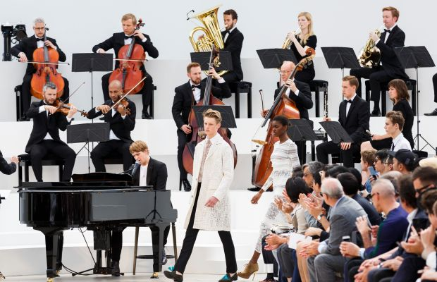 Burberry models walked the runway in front of a live orchestra at the brand's menswear show in June. Photo: Tristan Fewings/Getty Images