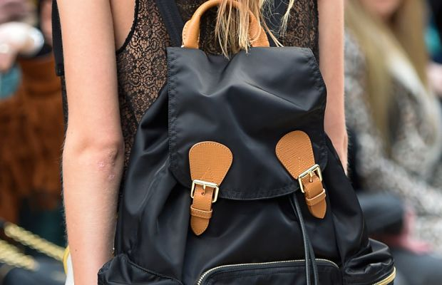 Burberry models carried monogrammed backpacks at Monday's show, which were available for pre-order immediately after the live-stream ended. Photo: Imaxtree
