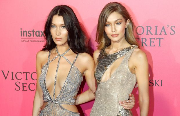 The sisters Hadid, all dressed up and ready to glow. Photo: Michael Stewart/FilmMagic/Getty Images
