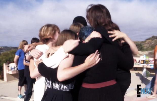 Jenner in a group hug at Kyler Prescott's memorial service. Screengrab: E!