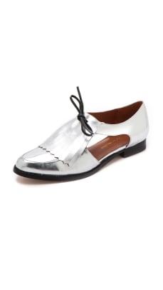 rebecca-minkoff-tassel-silver-loafers.jpg