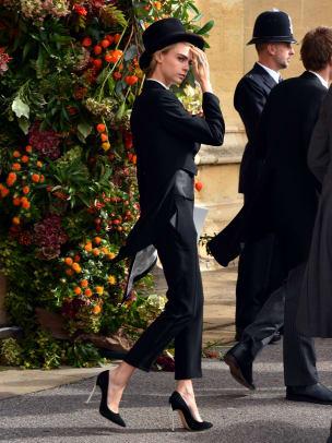 cara-delevingne-top-hat-tuxedo-princess-eugenie-royal-wedding-celebrity-guests
