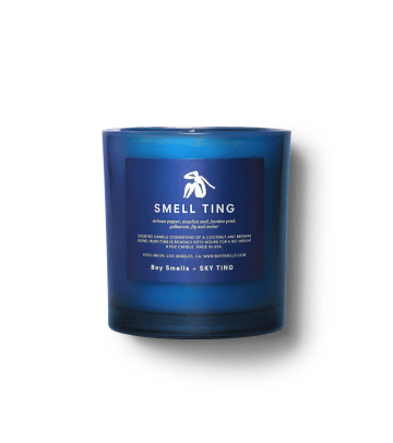 boy-smells-smell-ting-candle