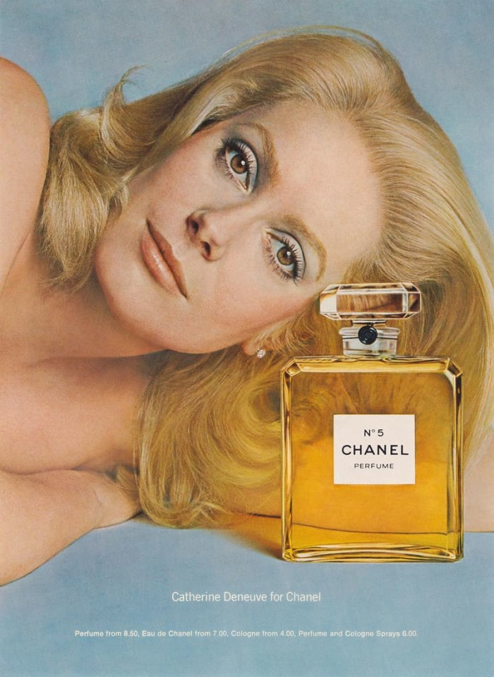 Catherine Deneuve appears in a 1975 Chanel No. 5 campaign. Photo: Courtesy of the Richard Avedon Foundation
